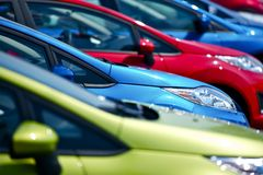 Colorful Cars Stock. Small European Vehicles in Stock. Many Colors to Choose From. Dealership Cars Stock. Transportation Photo Collection Royalty Free Stock Photo