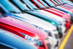 Colorful Cars Stock. Cars For Sale. Dealer Lot Cars Row Stock Photography