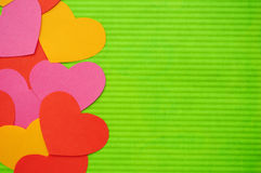 Colorful Cartoon hearts left side. Left side abstract simple hearts composition background. Paper cutout. Colorful Cartoon hearts Stock Photography