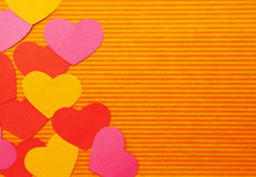 Colorful Cartoon hearts left side. Left side abstract simple hearts composition background. Paper cutout. Colorful Cartoon hearts royalty free stock photo
