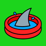 Colorful cartoon paddling pool with a shark fin Royalty Free Stock Image