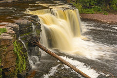 Colorful Cascade in the Wilds Stock Image