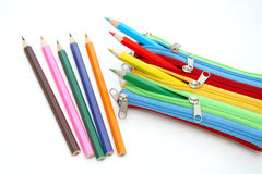 Colorful case with pencils inside and outside Royalty Free Stock Images