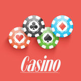 Colorful Casino chips on red background. Stock Photo
