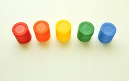 Colorful casino chips from a toy set stacked in a row Stock Images
