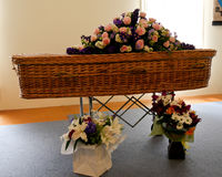 A colorful casket in a hearse or chapel before funeral or burial at cemetery Royalty Free Stock Photo