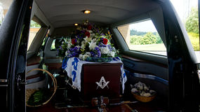 A colorful casket in a hearse or chapel before funeral or burial at cemetery Royalty Free Stock Images