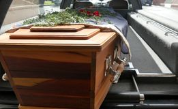 A colorful casket in a hearse or chapel before funeral or burial at cemetery. Closeup shot of a colorful casket in a hearse or chapel before funeral or burial at royalty free stock photo