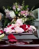A colorful casket in a hearse or church  before funeral. Closeup shot of a colorful casket in a hearse or church  before funeral Royalty Free Stock Image