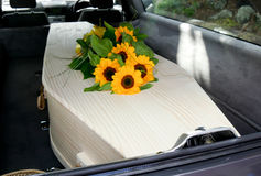 A colorful casket in a hearse or church  before funeral Royalty Free Stock Photos