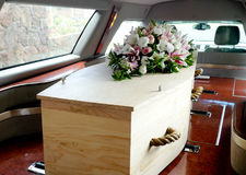 A colorful casket in a hearse or church  before funeral Royalty Free Stock Image