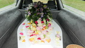 A colorful casket in a hearse or church  before funeral Stock Photo