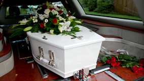 A colorful casket in a hearse or church  before funeral Royalty Free Stock Photo