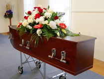 A colorful casket in a hearse or church  before funeral Stock Image