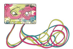 Colorful cassette tape. Colorful music cassette with jumbled mess of tape below Royalty Free Stock Photography
