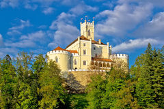Colorful castle on green hill royalty free stock images