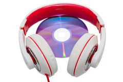 Colorful casual wired headphones and multimedia disc Stock Photos