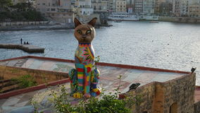 Colorful cat statue in the Independence Garden, Exiles bay, Malta Stock Image