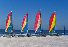 Colorful catamaran sailboats on a beach royalty free stock photography