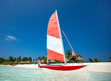 Colorful catamaran on the white sands of  beach Royalty Free Stock Photos