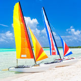 Colorful catamarans at a beach in Cuba Stock Photos