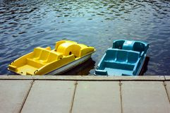 Colorful catamarans on the pier stock images