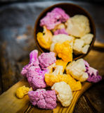 Colorful cauliflower on rustic background Stock Image