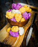 Colorful cauliflower on rustic background Royalty Free Stock Images