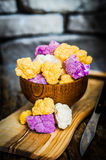 Colorful cauliflower on rustic background Royalty Free Stock Photo
