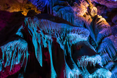 Colorful cave. Brightly lit with colorful lights geological shapes inside a cave stock photos