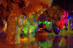 Colorful cave and lake underground, Fujian, South of China. Colorful stone and lake underground in YuHua Cave, a Karst cave, located in Taining, Fujian province Royalty Free Stock Photography