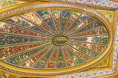 The colorful ceiling of the Althiburos Room. TUNIS, TUNISIA - SEPTEMBER 2, 2015: The ceiling of the Althiburos Room of Bardo National Museum covered with Royalty Free Stock Image