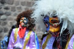 Colorful celebration in Cuzco, Peru. There is always some kind of street celebration in Cuzco, Peru. The locals wear colorful costumes and masks, and walk, sing royalty free stock image