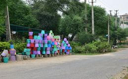 Colorful cement flower pots stacked up on the side of road Royalty Free Stock Images