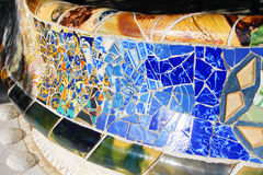Colorful ceramic bench in Park Guell. Park Guell (1914) is the famous architectural town art . Barcelona, Spain Royalty Free Stock Photos