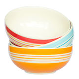 Colorful Ceramic Bowls. Stacked On Each Other Over White Stock Images