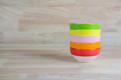 Colorful Ceramic Bowls Stacked On Each Other on Wood Background Stock Images