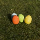 Colorful ceramic easter eggs which are standing in the grass. Four colorful ceramic easter eggs which are standing in the grass. Place for Easter greetings royalty free stock photography