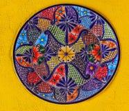 Colorful Ceramic Mexican Plate Guanajuato Mexico. Colorful Ceramic Mexican Plate Yellow Wall Guanajuato Mexico stock photo