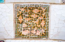 Colorful ceramic mosaics in park Guell, Barcelona. Famous colorful ceramic mosaics detail, designed by Antonio Gaudi and better known as trencadis. Located in Stock Photo
