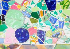 Colorful ceramic mosaics in park Guell, Barcelona. Famous colorful ceramic mosaics detail, designed by Antonio Gaudi and better known as trencadis. Located in Stock Image