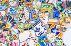 Colorful ceramic mosaics in park Guell, Barcelona. Famous colorful ceramic mosaics detail, designed by Antonio Gaudi and better known as trencadis. Located in Royalty Free Stock Photography