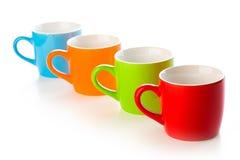 Colorful ceramic mugs Stock Photos