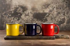 Colorful ceramic mugs royalty free stock photos