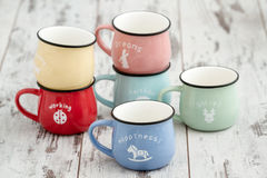Colorful Ceramic Mugs with Enamel Look Stock Photo