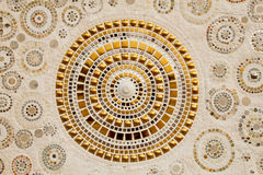 Colorful ceramic pattern decoration with pebbles made from pebble and ceramic on the wall stock photos