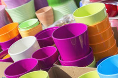 Colorful ceramic pots in market, sunny day. Colorful ceramic pots in market, collection of flowerpots Stock Images