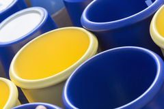 Colorful ceramic pots in market, sunny day. Colorful ceramic pots in market, collection of flowerpots, blue and yellow Royalty Free Stock Photo