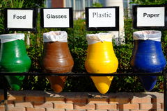 Colorful ceramic pots for separate garbage Royalty Free Stock Image