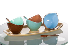 Colorful ceramic sauce boats. Three colorful ceramic sauce boats Royalty Free Stock Photography